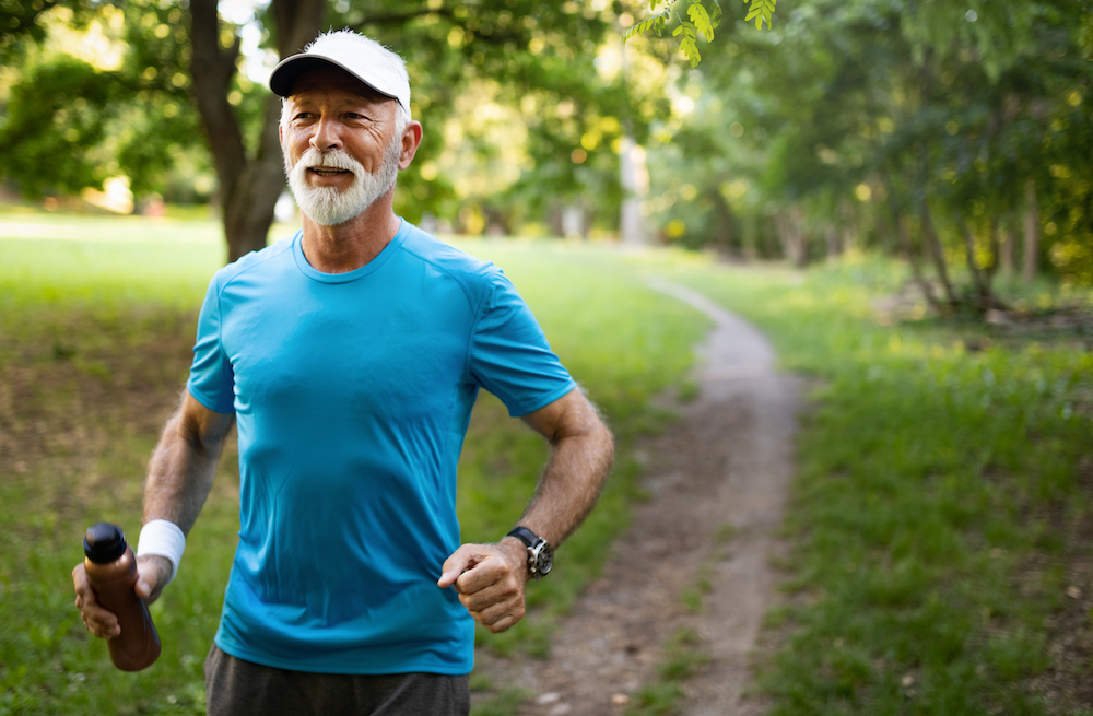 Man jogging in park after signing life lease