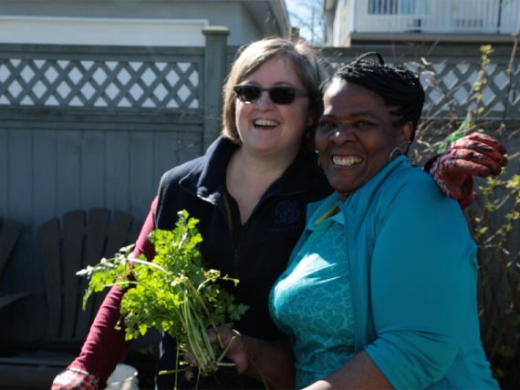Two women enjoying the community gardens
